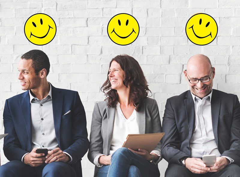 3 business people smiling with smiley face above heads